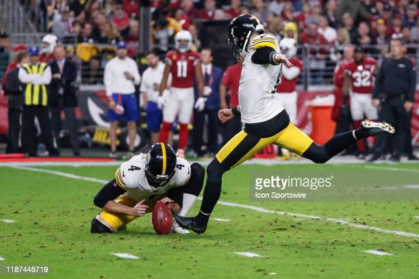 Pittsburgh Steelers kicker Chris Boswell kicks an extra point held by Pittsburgh Steelers punter Jordan Berry during the NFL football game between...