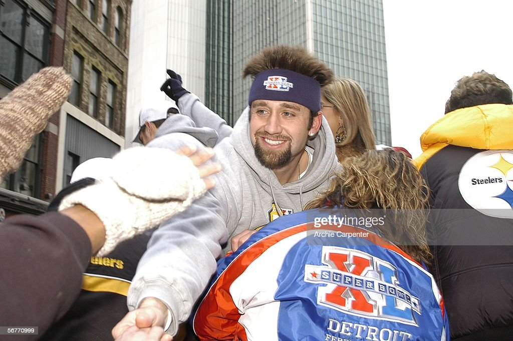 Pittsburgh Steelers kicker Jeff Reed is swarmed by fans during the victory parade celebrating the win at Super Bowl XL in downtown Pittsburgh, Pennsylvania on February 7, 2006.