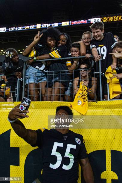 Pittsburgh Steelers linebacker Devin Bush takes a selfie with fans during the NFL football game between the Tampa Bay Buccaneers and the Pittsburgh...