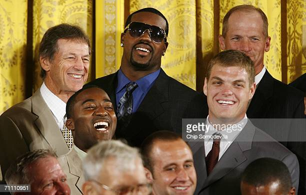 Pittsburgh Steelers linebacker Joey Porter laughs while listening to US President George W Bush in the East Room of the White House June 2 2006 in...