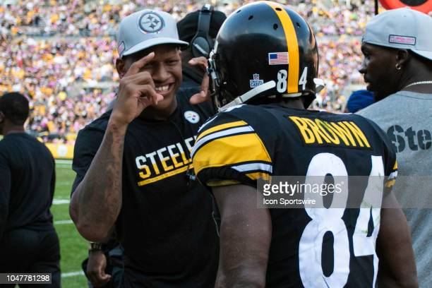 Pittsburgh Steelers linebacker Ryan Shazier pretends to take a photo of Pittsburgh Steelers wide receiver Antonio Brown during the NFL football game...