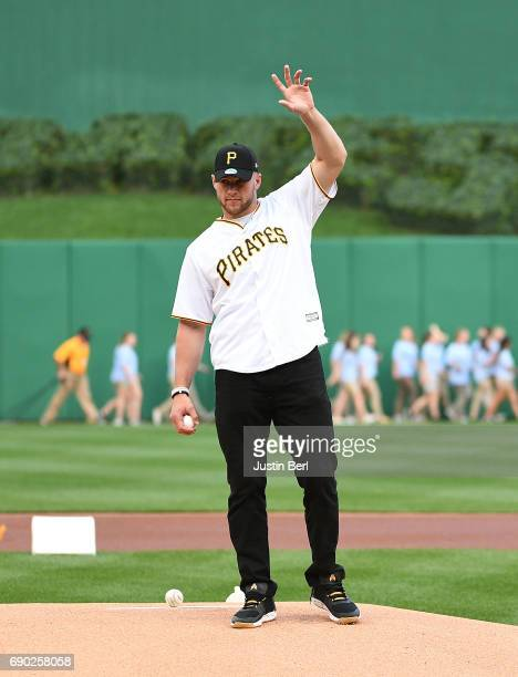 Pittsburgh Steelers linebacker TJ Watt throws out the first pitch before the game between the Pittsburgh Pirates and the Arizona Diamondbacks at PNC...
