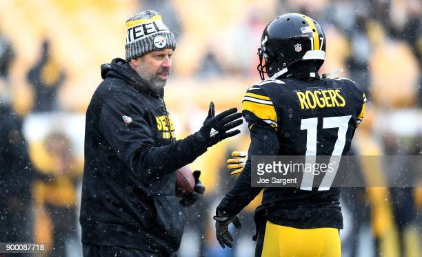 Pittsburgh Steelers offensive coordinator Todd Haley talks to Eli Rogers during warmups before the game against the Cleveland Browns at Heinz Field...