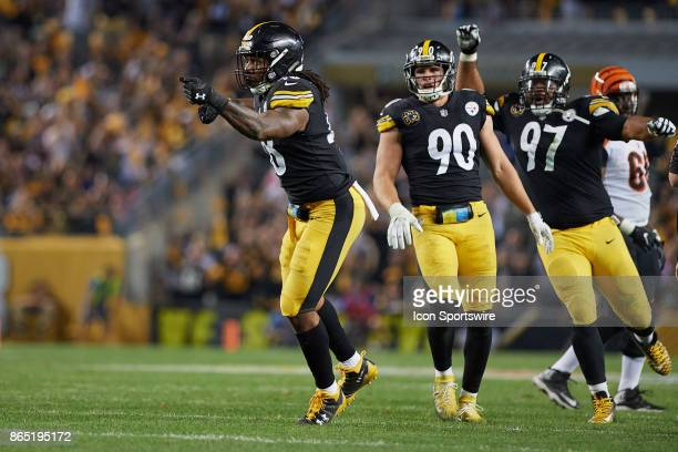 Pittsburgh Steelers outside linebacker Bud Dupree outside linebacker TJ Watt and defensive end Cameron Heyward celebrate Bud Dupree sacking...