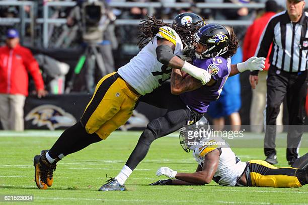 Pittsburgh Steelers outside linebacker Jarvis Jones hits Baltimore Ravens wide receiver Chris Moore after a pass reception in the first quarter on...