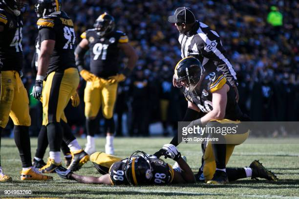 Pittsburgh Steelers outside linebacker TJ Watt checks on Pittsburgh Steelers inside linebacker Vince Williams after he was injured during the AFC...