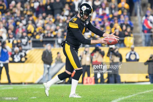Pittsburgh Steelers punter Jordan Berry focuses on the ball before kicking during the NFL football game between the Buffalo Bills and the Pittsburgh...