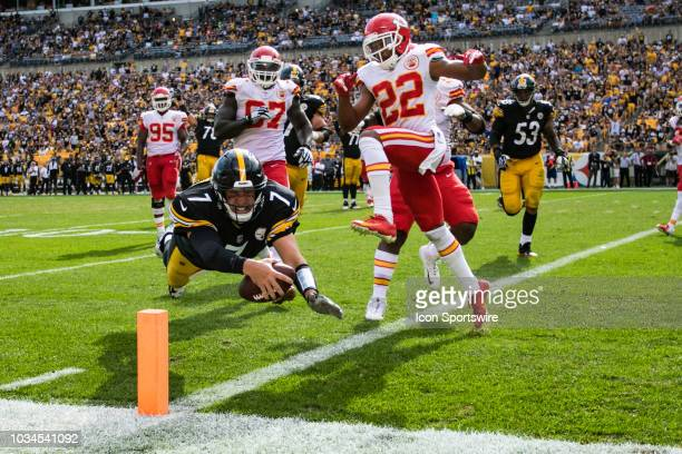 Pittsburgh Steelers quarterback Ben Roethlisberger dives ahead for the pylon and scores a touchdown during the NFL football game between the Kansas...