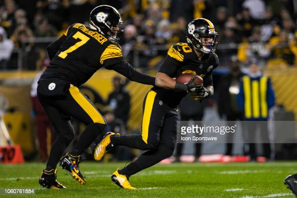 Pittsburgh Steelers quarterback Ben Roethlisberger hands off the bat to Pittsburgh Steelers running back James Conner during the NFL football game...