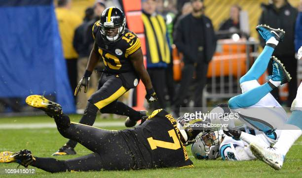 Pittsburgh Steelers quarterback Ben Roethlisberger slides after running for yardage as Carolina Panthers safety Eric Reid right looks to make the...