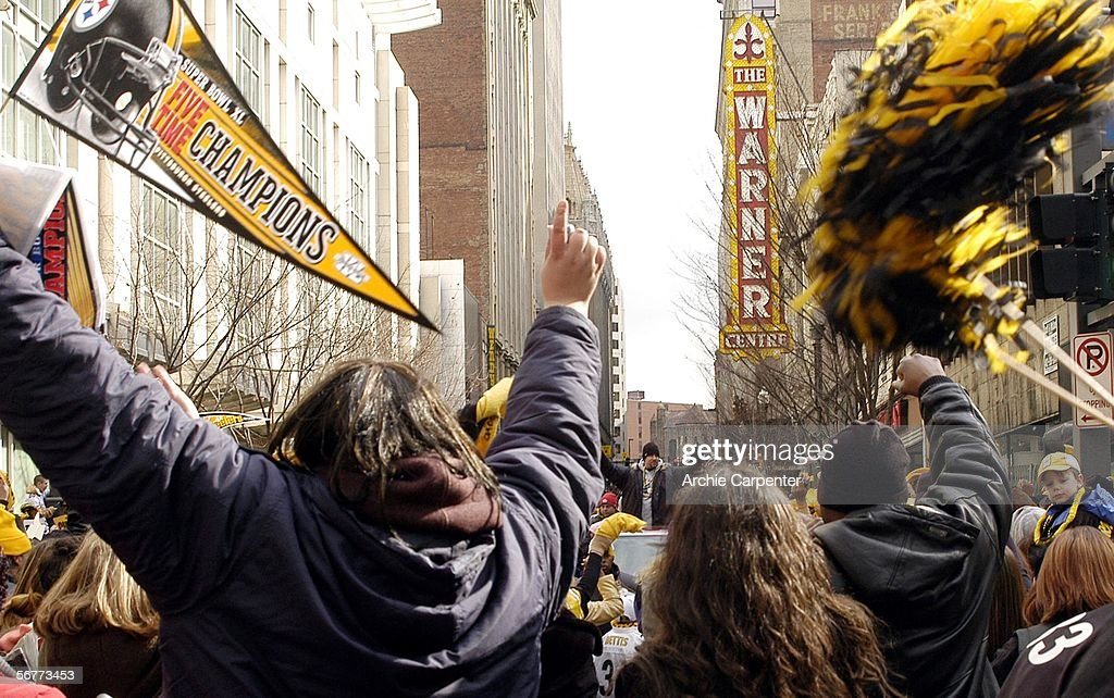 Pittsburgh Steelers quarterback Ben Roethlisberger waves to the crowd of over an estimated 250,000 during the victory parade celebrating the win at Super Bowl XL on February 7, 2006 in downtown Pittsburgh, Pennsylvania.