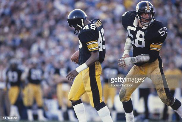 Pittsburgh Steelers' quarterback Jack Lambert follows a teammate to the play during Super Bowl X against the Dallas Cowboys at the Orange Bowl in...