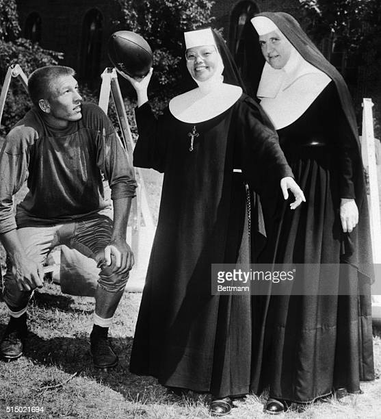 Pittsburgh Steelers' Quarterback Johnny Unitas shows Sister M Theresa Hung of Shishi China how they play football in the United States Looking on is...