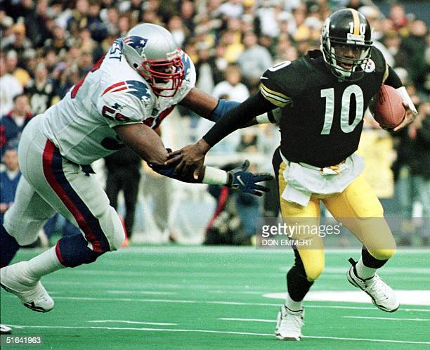 Pittsburgh Steelers quarterback Kordell Stewart stays just out of reach of New England Patriots defender Willie McGinest during second half action 03...