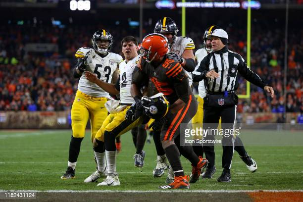 Pittsburgh Steelers quarterback Mason Rudolph reacts after being hit with his own helmet by Cleveland Browns defensive end Myles Garrett with 008...