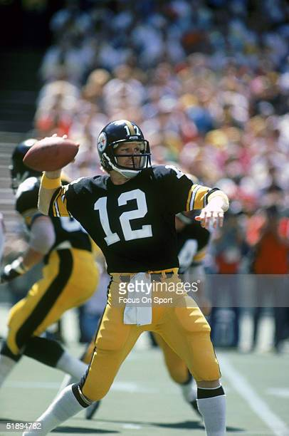 Pittsburgh Steelers quarterback Terry Bradshaw attempts a pass during a game circa 1980's