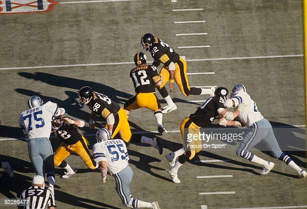 Pittsburgh Steelers' quarterback Terry Bradshaw hands off to Franco Harris during Super Bowl X against the Dallas Cowboys at the Orange Bowl on...
