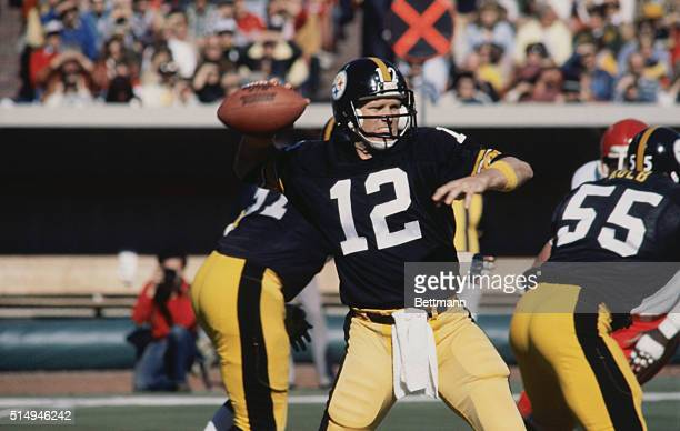 Pittsburgh Steelers' quarterback Terry Bradshaw prepares to throw a pass to one of his fellow teammates