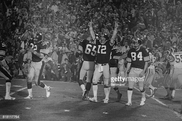 Pittsburgh Steelers quarterback Terry Bradshaw who was named the Most Valuable Player of Super Bowl XIV at the Rose Bowl Jan 20 holds his hands up in...