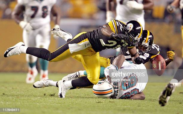 Pittsburgh Steelers' Ricardo Colclough and Ryan Clark break up a pass intended for Miami Dolphins' Marty Booker during the second quarter at Heinz...