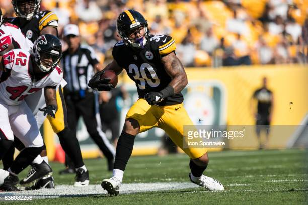 Pittsburgh Steelers Running back James Conner carries the ball and makes a cut during a preseason game between the Atlanta Falcons and the Pittsburgh...