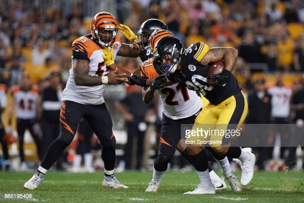 Pittsburgh Steelers running back James Conner carries the ball during an NFL game between the Cincinnati Bengals and the Pittsburgh Steelers on...