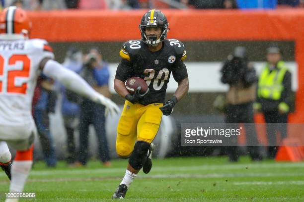 Pittsburgh Steelers running back James Conner carries the football during the second quarter of the National Football League game between the...