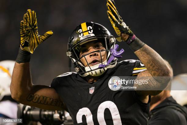 Pittsburgh Steelers running back James Conner celebrates after a touchdown during the NFL football game between the Los Angeles Chargers and the...