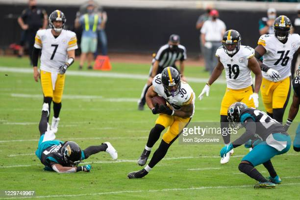 Pittsburgh Steelers Running Back James Conner escapes a tackle attempt from Jacksonville Jaguars Cornerback Chris Claybrooks during the game between...