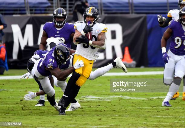 Pittsburgh Steelers running back James Conner is tackled by Baltimore Ravens defensive end Yannick Ngakoue during the Pittsburgh Steelers game versus...