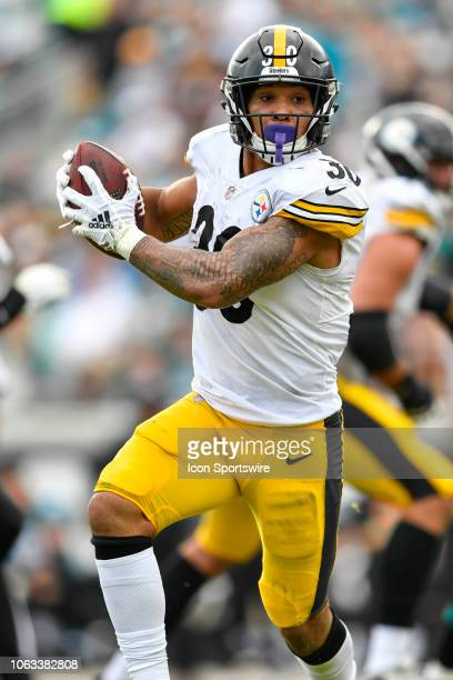 Pittsburgh Steelers running back James Conner runs after a reception during the second half of an NFL game between the Pittsburgh Steelers and the...