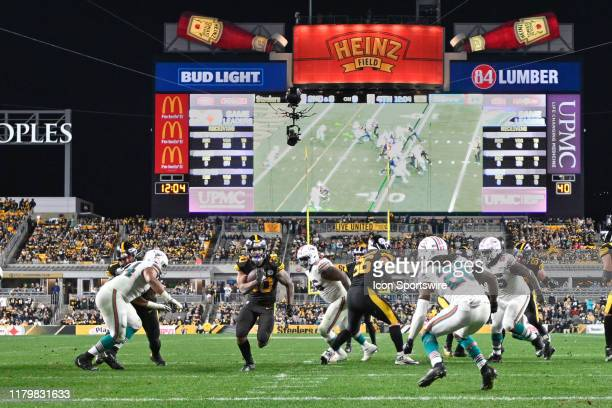 Pittsburgh Steelers running back James Conner runs toward the end zone before scoring a touchdown in the fourth quarter during the game between...