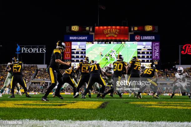 Pittsburgh Steelers running back James Conner runs with the ball from his own end zone during the NFL football game between the Miami Dolphins and...