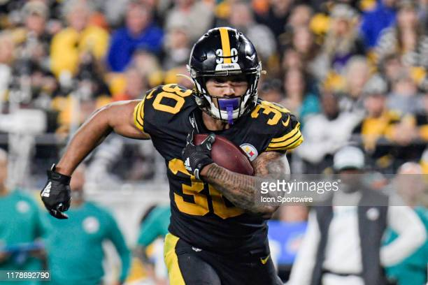 Pittsburgh Steelers running back James Conner runs with the ball in the second quarter during the game between Pittsburgh Steelers and Miami Dolphins...