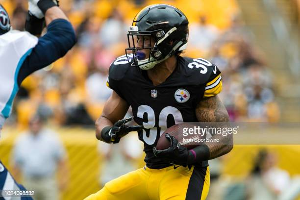 Pittsburgh Steelers Running Back James Conner runs with the ball during the preseason NFL game between the Tennessee Titans and Pittsburgh Steelers...