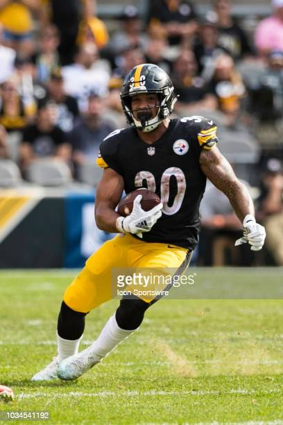 Pittsburgh Steelers running back James Conner runs with the ball during the NFL football game between the Kansas City Chiefs and Pittsburgh Steelers...