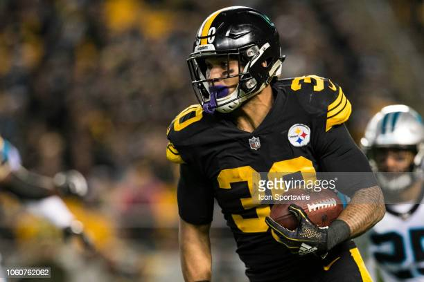 Pittsburgh Steelers running back James Conner runs with the ball during the NFL football game between the Carolina Panthers and the Pittsburgh...