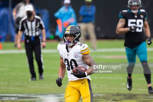 Pittsburgh Steelers Running Back James Conner runs with the ball during the game between the Pittsburgh Steelers and the Jacksonville Jaguars on...