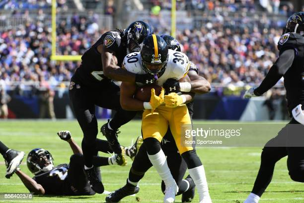Pittsburgh Steelers running back James Conner rushes and is brought down by Baltimore Ravens cornerback Brandon Carr on October 1 at MT Bank Stadium...