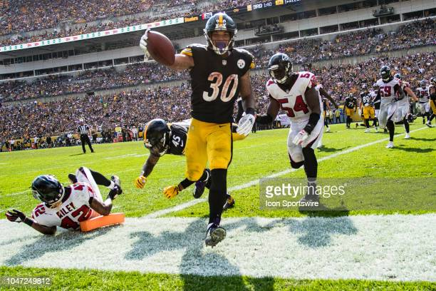 Pittsburgh Steelers running back James Conner scores a rushing touchdown during the NFL football game between the Atlanta Falcons and the Pittsburgh...