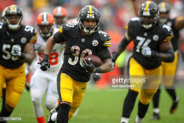 Pittsburgh Steelers running back James Conner scores on a 22 yard touchdown run during the third quarter of the National Football League game between...
