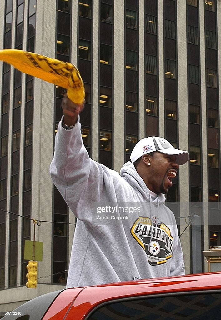 Pittsburgh Steelers running back Joey Porter waves a terrible towel during the victory parade celebrating winning Super Bowl XL February 7, 2006 in downtown Pittsburgh Pennsylvania.