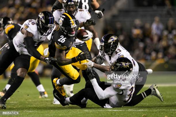 Pittsburgh Steelers Running Back Le'Veon Bell fights for extra yards as he's brought down by Baltimore Ravens Linebacker Patrick Onwuasor during the...