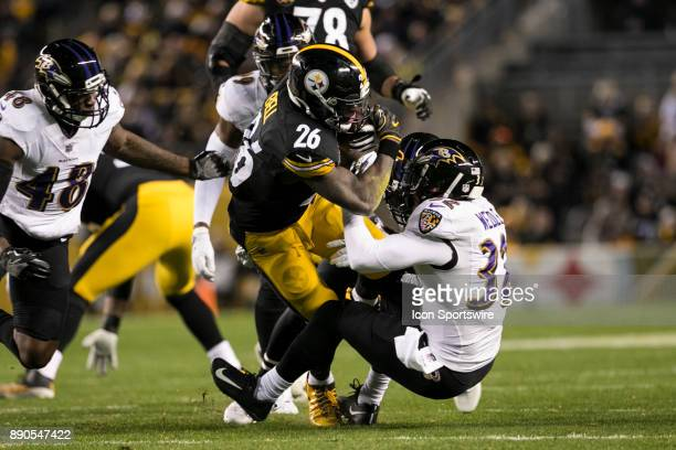 Pittsburgh Steelers Running Back Le'Veon Bell runs over Baltimore Ravens Safety Eric Weddle during the game between the Baltimore Ravens and the...