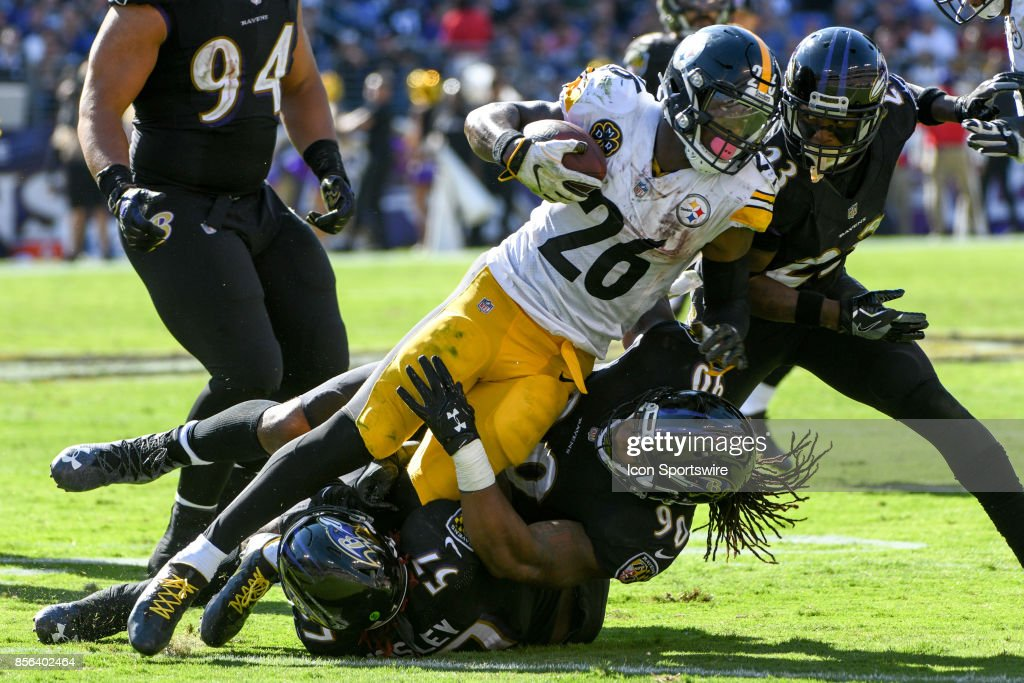 Pittsburgh Steelers running back Le'Veon Bell (26) rushes and is brought down by Baltimore Ravens defensive end Za'Darius Smith (90) in the fourth quarter on October 1, 2017, at M&T Bank Stadium in Baltimore, MD. The Pittsburgh Steelers defeated the Baltimore Ravens, 26-9.