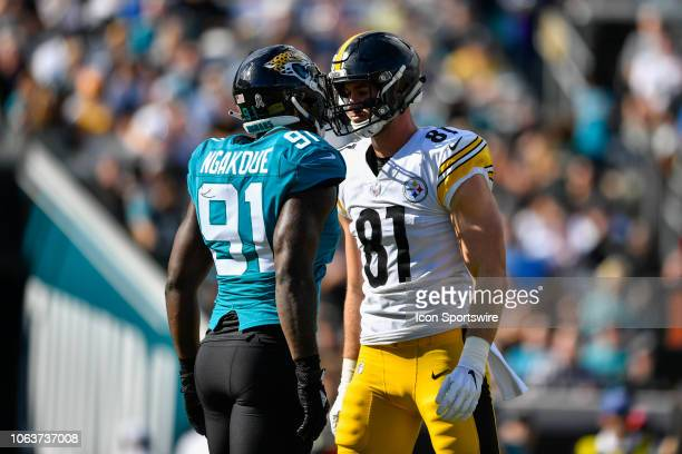 Pittsburgh Steelers tight end Jesse James and Jacksonville Jaguars defensive end Yannick Njakoue exchange words during the first half of an NFL game...