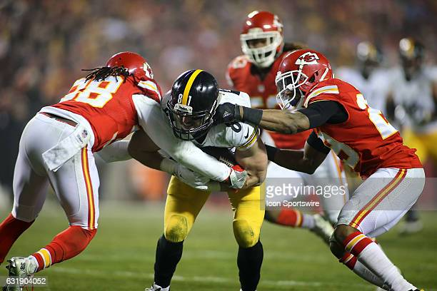 Pittsburgh Steelers tight end Jesse James is tackled by Kansas City Chiefs strong safety Eric Berry and free safety Ron Parker in the second quarter...