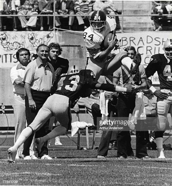 Pittsburgh Steelers tight end Randy Grossman attempts to jump over Raiders safety George Atkinson during a 28 to 31 loss to the Oakland Raiders on...