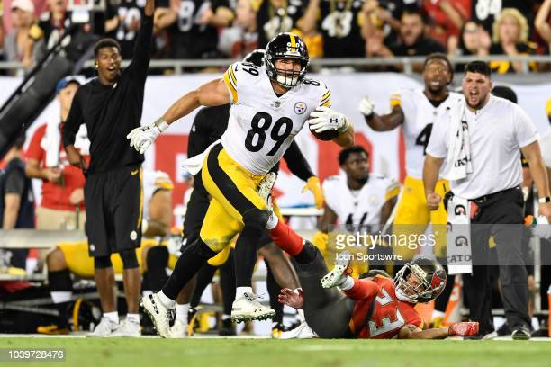 932ea41d7 Pittsburgh Steelers tight end Vance McDonald breaks a tackle after a  reception and runs in for. Editorial use only