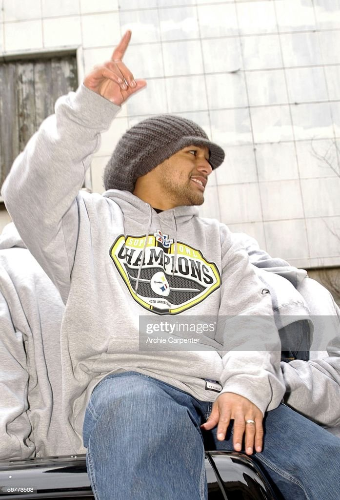 Pittsburgh Steelers Troy Polamalu with his signature hair in a hat waves to the crowd of over an estimated 250,000 during the victory parade celebrating the win at Super Bowl XL on February 7, 2006 in downtown Pittsburgh, Pennsylvania.